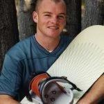 Son Eric holding snowboard