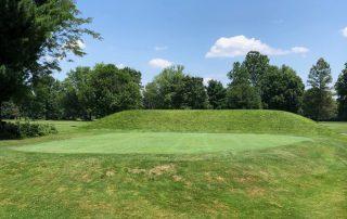 Mound surrounding golf green